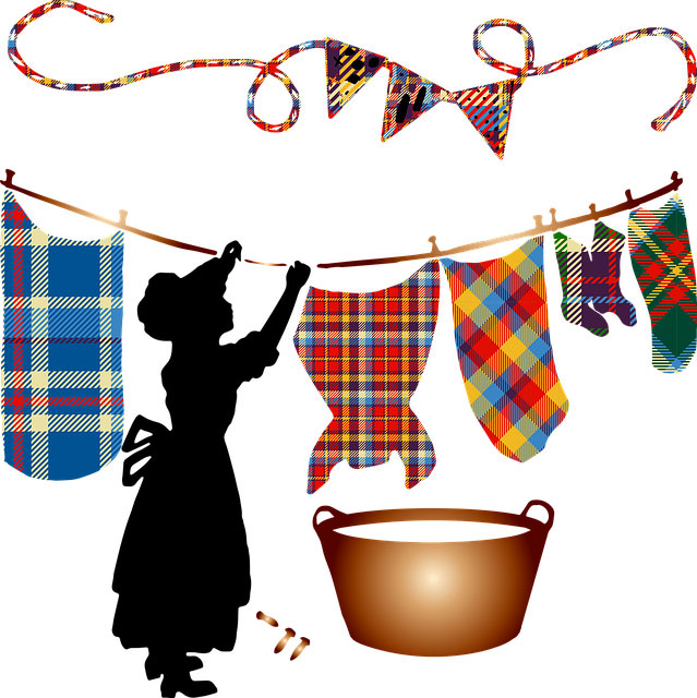 Woman washing and hanging clothes